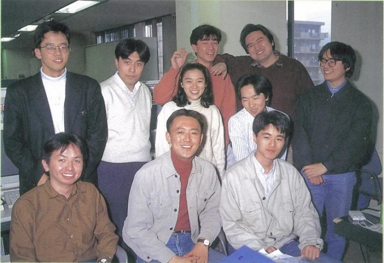 Nagoshi in the middle, and Makoto Osaki on the very left in the development of Daytona USA.